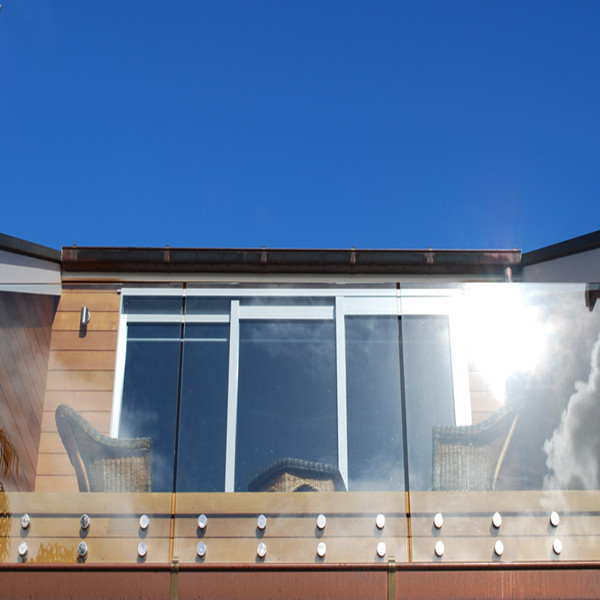 frameless glass railing system with stainless steel standoff
